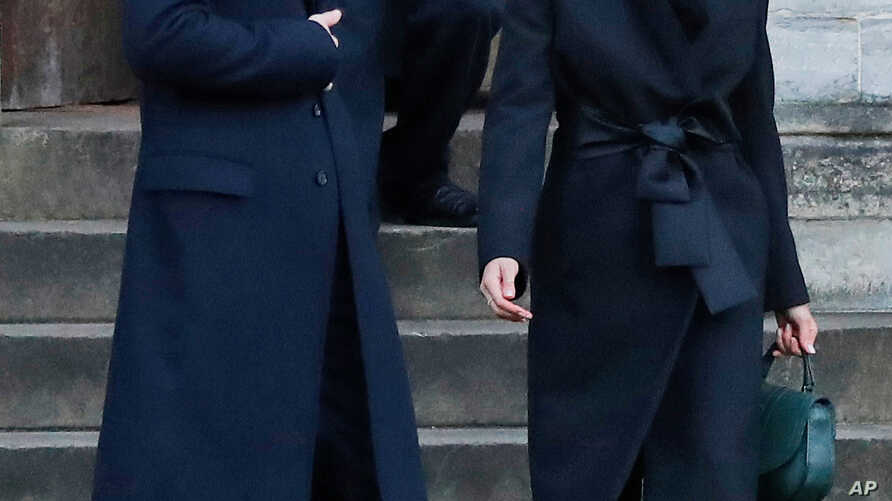 FILE - In this Jan.18, 2018 photo, Britain's Prince Harry and his fiancee Meghan Markle leave after a visit to Cardiff Castle in Cardiff.  When Meghan wore jeans from the Hiut Denim Company, there was worldwide publicity about a firm in Wales which s