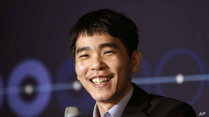 South Korean professional Go player Lee Sedol smiles as he speaks during a press conference after winning the fourth match against Google's artificial intelligence program, AlphaGo, in Seoul, South Korea, March 13, 2016.