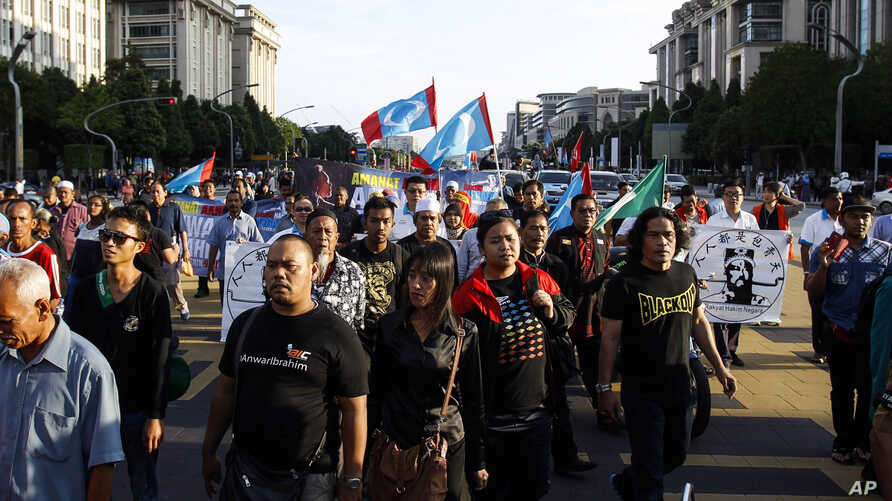 Supporters of Malaysian opposition leader Anwar Ibrahim march towards the Palace of Justice at Putrajaya, Malaysia, Tuesday, Feb. 10, 2015.