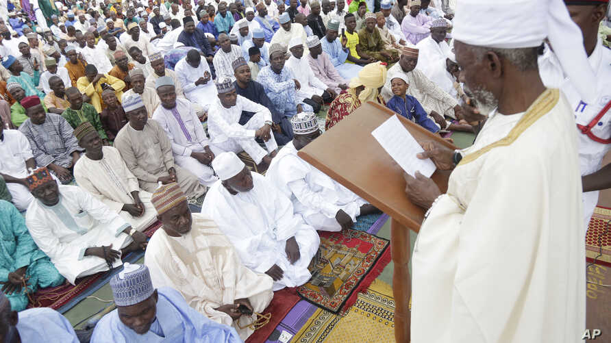 Nigeria Muslims listen to the sermon by Imam Bashir Umar, during Eid al-Fitr prayers in Lagos, Nigeria, to mark the end of the month of Ramadan, June 25, 2017.