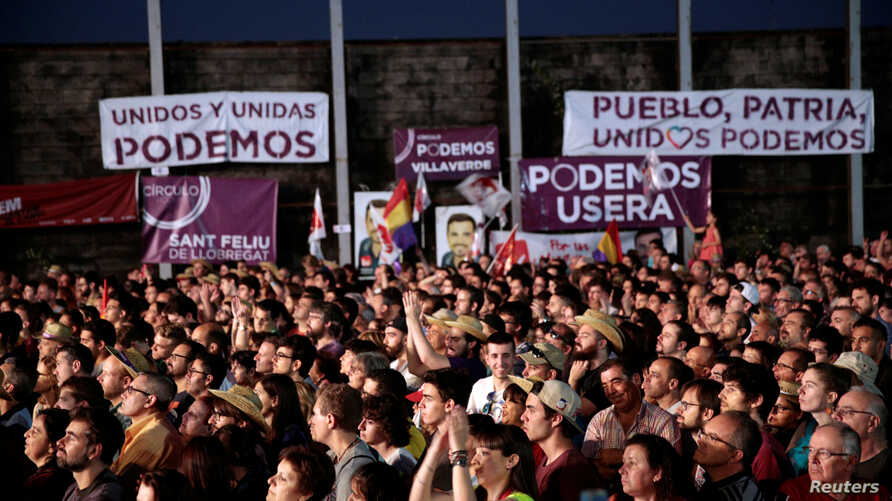 Supporters attend the last campaign rally of the coalition Unidos Podemos (Together We Can) for Spain's upcoming general election in Madrid, Spain, June 24, 2016.
