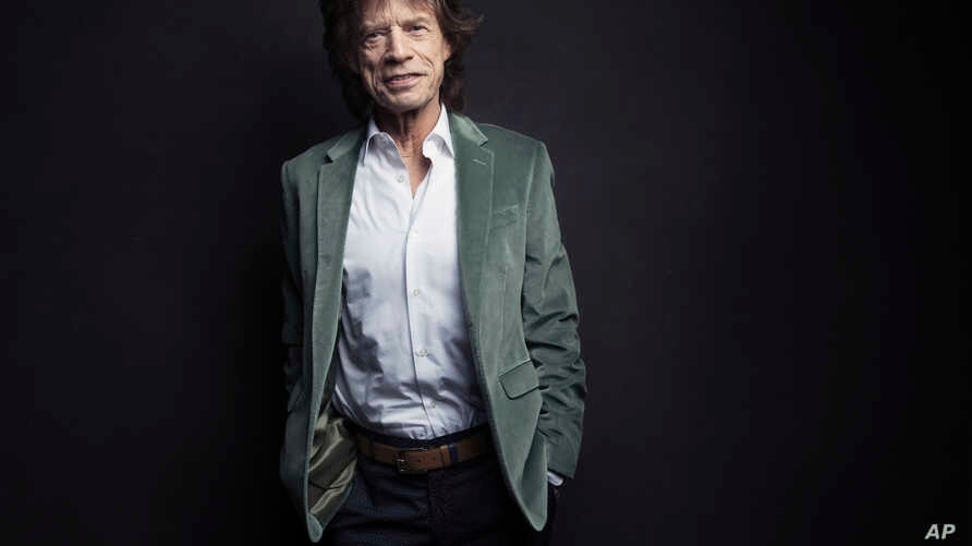 FILE - Mick Jagger of the Rolling Stones poses for a portrait in New York, Nov. 14, 2016.