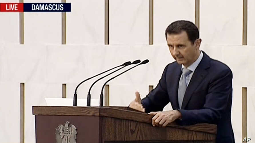 Syrian President Bashar Assad delivering a speech in Damascus, Syria, Sunday. This image is made from video broadcast on Press TV, Iran's English language state-run channel, July 26, 2015.