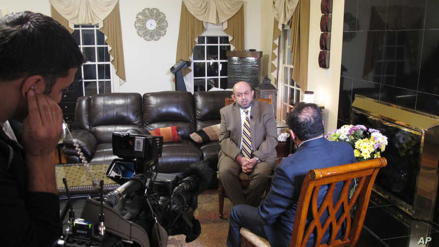 Dr. Mohammad Abu-Salha, whose two daughters and son-in-law were shot to death last February by a disgruntled neighbor, speaks with a crew from Al Jazeera America at the home of his in-laws in Raleigh, N.C., about growing anti-Muslim sentiment in his