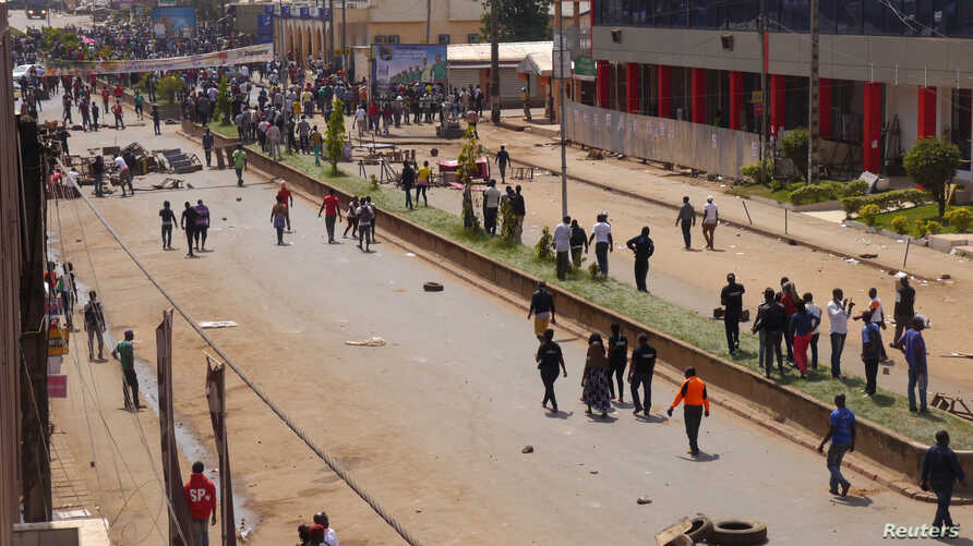 FILE - Anti-government demonstrators block a road in Bamenda, Cameroon, Dec. 8, 2016.