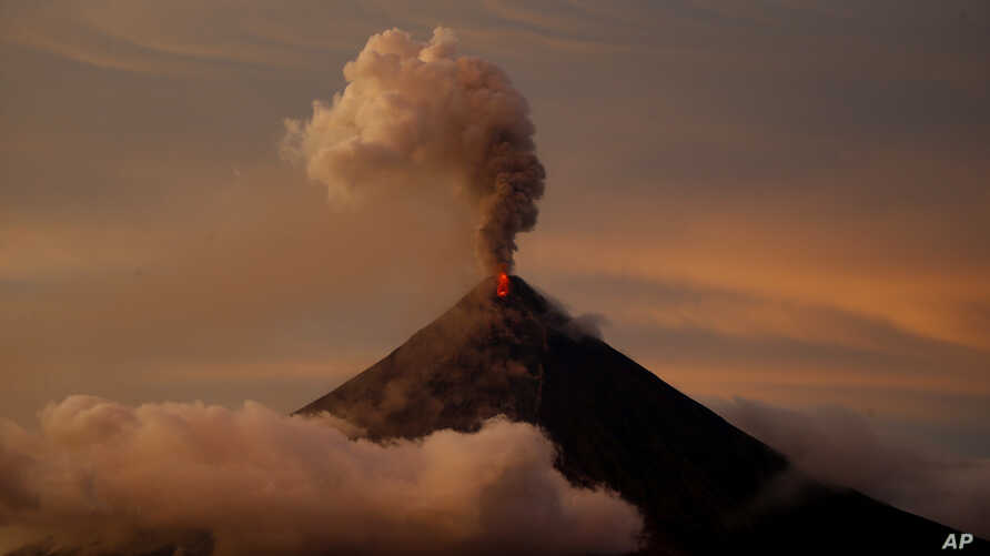 The Mayon volcano erupts anew at sunset in Albay province, Jan. 26, 2018.