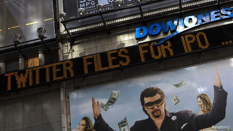 A news ticker in New York's Times Square announces an initial public offering for Twitter Inc., Sep. 13, 2013.