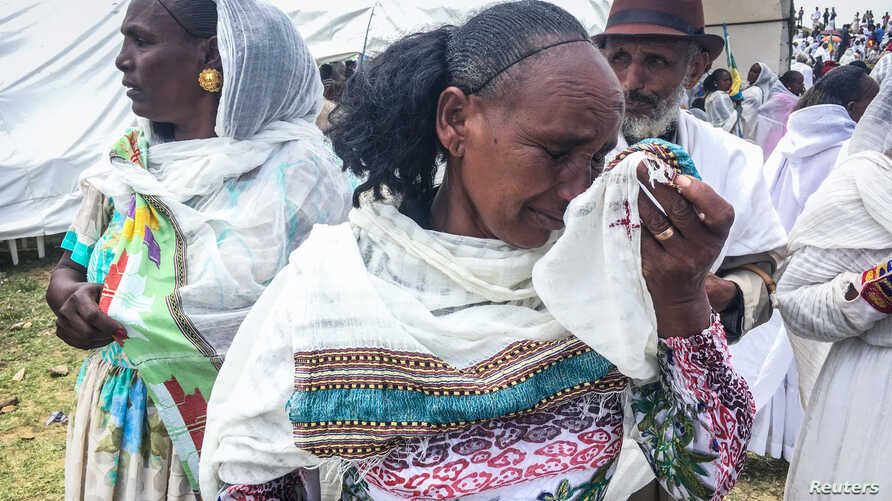 FILE - An Ethiopian woman cries after meeting relatives from Eritrea during the border reopening ceremony on Sept. 11, 2018, as two land border crossings between Ethiopia and Eritrea were reopened for the first time in 20 years at Zalambessa, norther