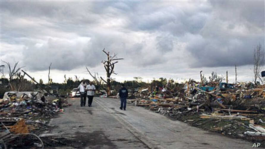 Residents search through what is left of their homes after a tornado hit Pleasant Grove west of downtown Birmingham , Alabama, a day earlier, Apr 28 2011