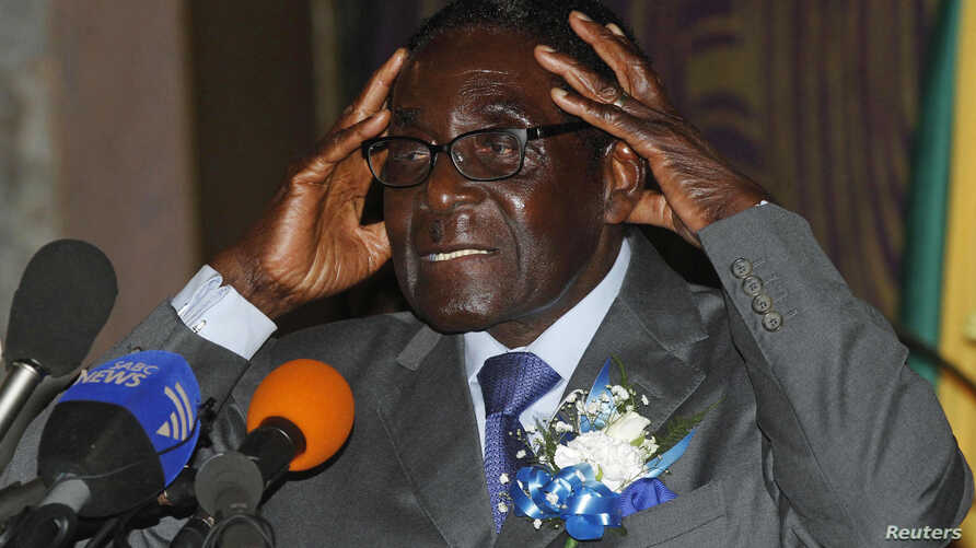 Zimbabwe's President Robert Mugabe speaks at the start of a conference of parties and civic society groups reviewing a draft constitution that, if adopted, will lead to Zimbabwe's next election, at a hotel in Harare, October 22, 2012.
