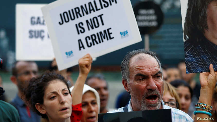 FILE - Demonstrators shout slogans during a protest against the arrest of three prominent activists for press freedom, in central Istanbul, Turkey, June 21, 2016. Arrest warrants for 42 Turkish journalists were issued Monday in connection with the fa