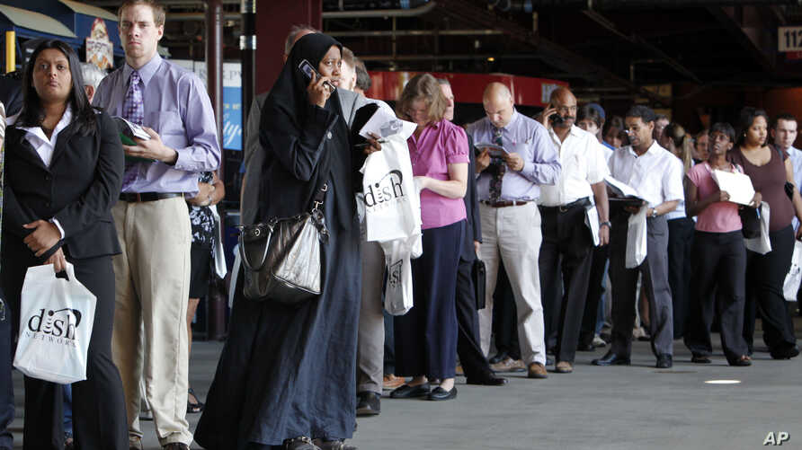 FILE – In this July 15, 2009, file photo, job seekers wait
