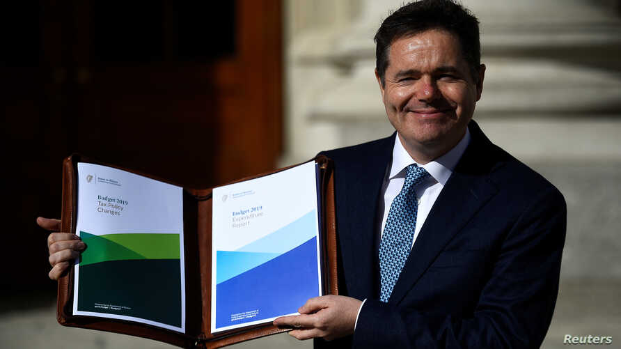 Ireland's Minister for Finance Paschal Donohoe displays a copy of the 2019 budget on the steps of Government Buildings in Dublin, Ireland Oct. 9, 2018.