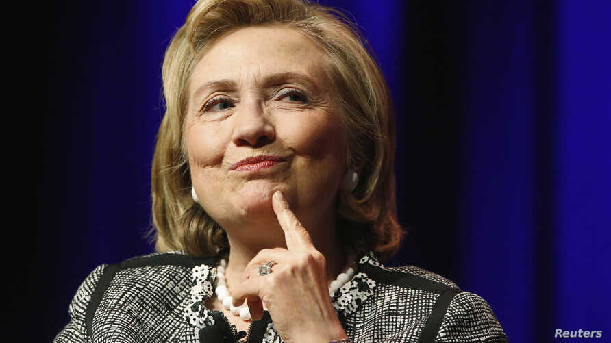 """FILE - Former U.S. Secretary of State Hillary Clinton reacts to a question as she discusses her new book """"Hard Choices: A Memoir"""" at George Washington University in Washington, June 13, 2014."""