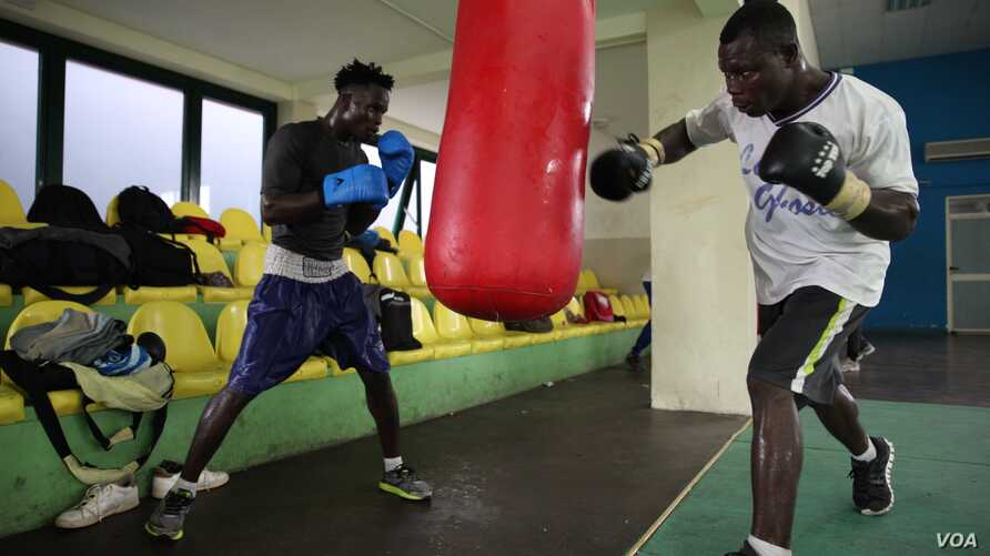 Boxers train at a gym near the sports stadium, Accra, Ghana, Sept. 10. (Chris Stein/VOA)