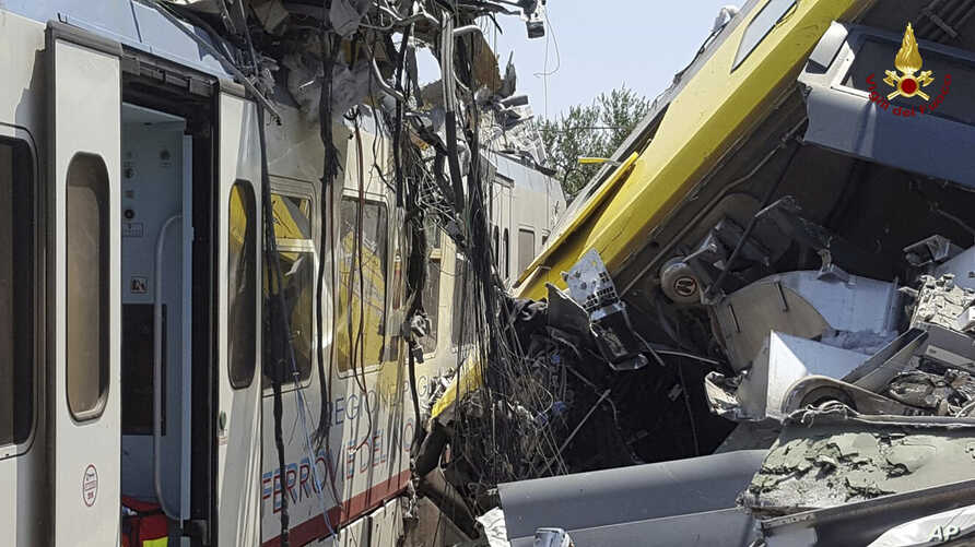 Italy Train Crash: Crumpled wagon cars are seen after after two commuter trains collided head-on near the town of Andria, in the southern region of Puglia, killing several people, Tuesday, July 12, 2016.