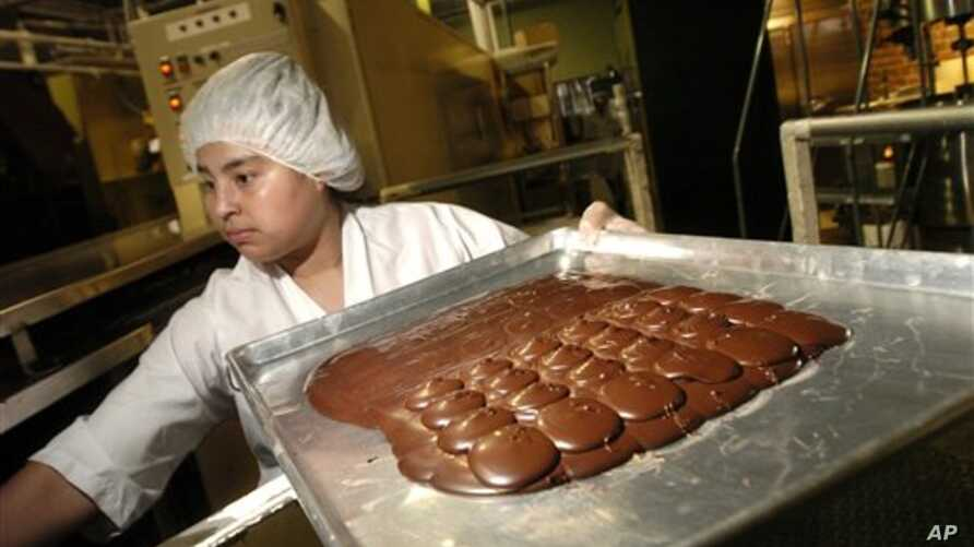 ** FILE ** Reyna Murillo makes chocolate at the Scharffen Berger chocolate factory in Berkeley, Calif., in this Feb. 7, 2007 file photo.  The company was one of three premium chocolate companies recently purchased by Hershey's as it pursues high-end