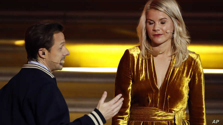French DJ and musician Martin Solveig, left, talks to Olympique Lyonnais' Ada Hegerberg, of Norway, during the Golden Ball (Ballon d'Or) award ceremony at the Grand Palais in Paris, Dec.3, 2018. After asking the first woman to win the Ballon d'Or if