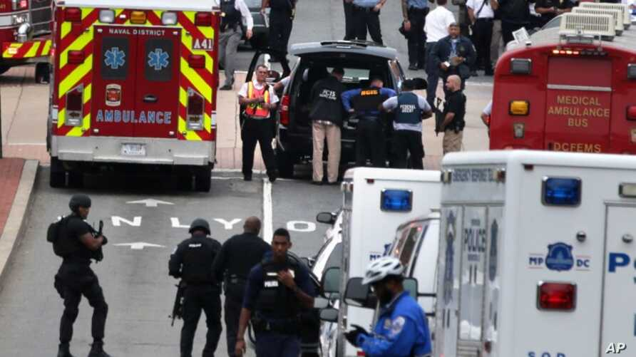 Emergency vehicles and law enforcement personnel respond to a shooting at an entrance to the Washington Navy Yard, Sept. 16, 2013, Washington, DC.