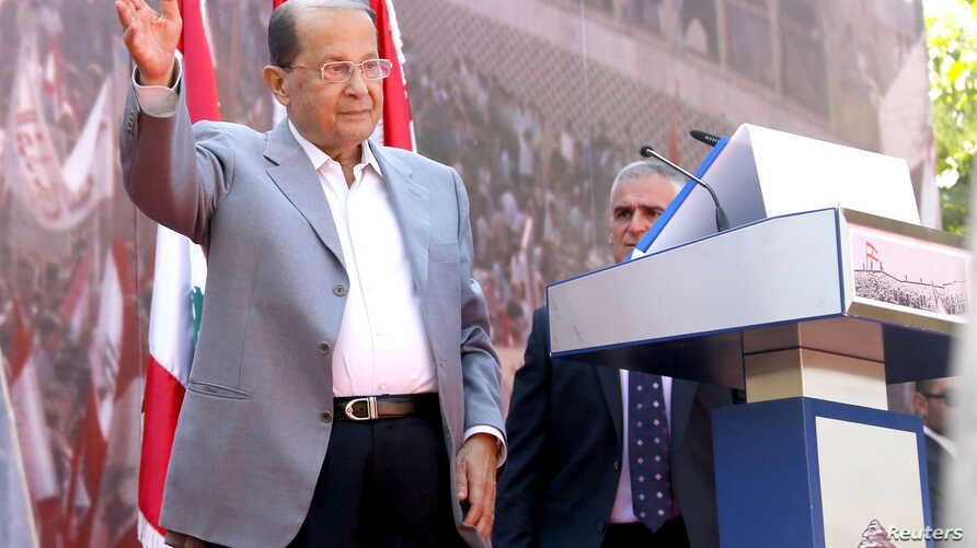 Lebanese Christian leader and founder of the Free Patriotic Movement (FPM) Michel Aoun greets his supporters during a rally to show support for him and to mark the October 13 anniversary, near the presidential palace in Baabda, near Beirut, Lebanon, ...