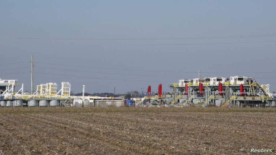FILE - Idled drilling rigs owned by contractor Helmerich & Payne International Drilling Company sit on a lot in Seguin, Texas, Jan. 13, 2016.