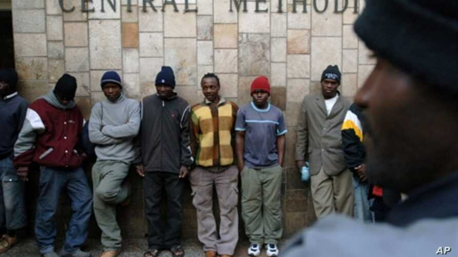 Refugees, mostly from Zimbabwe stand outside the Central Methodist Church in Johannesburg, 30 Jun 2008