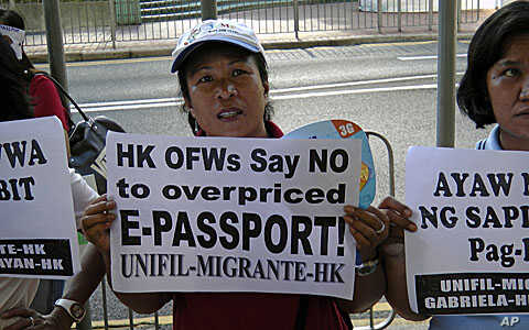 Filipino workers in Hong Kong protest e-passport fees