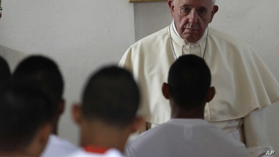 Pope Francis listens to the words of an inmate at the Las Garzas de Pacora detention center for minors before the start of a penitential Mass, in Panama, Jan. 25, 2019.