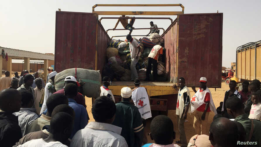 Migrants deported from Algeria gather to retrieve their belongings at the International Organization for Migration transit center in Agadez, Niger, May 6, 2016. According to a Human Rights Watch report released on Friday, Dec. 9, 2016, over 1,400 mig