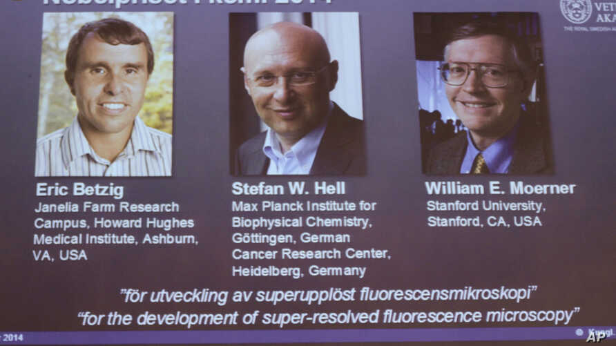 Images of the three winners of the 2014 Nobel Prize for Chemistry, from left, American Eric Betzig, German Stefan Hell and American William Moerner are projected on a screen at the Royal Swedish Academy of Sciences in Stockholm, Oct. 8 2014.