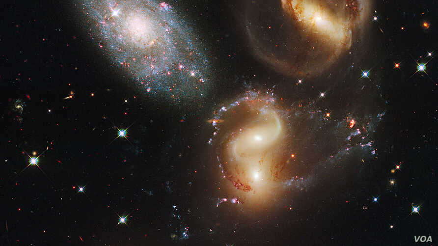 Four of these five galaxies in Stephan's Quintet are so close together they are bound together by gravity and will eventually merge into a single galaxy. The galaxy at top left is in the foreground, far from the other members.