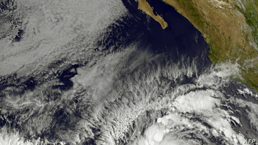 This image obtained from the NOAA-NASA shows Tropical Storm Andres (b) on May 28, 2015. Andres, which formed off the Mexican coast in the early morning hours Thursday, was located about 690 miles (1,110 kilometers) southwest of Manzanillo at 10:00 am