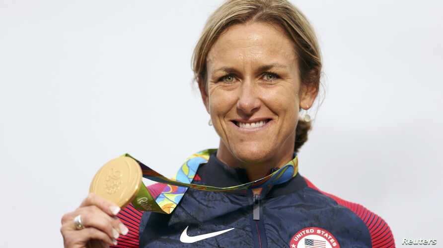 Cyclist Kristin Armstrong of the United States poses with her gold medal, Rio de Janeiro, Brazil, Aug. 10, 2016.