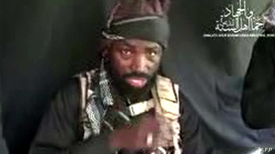 This screen grab image taken on September 25, 2016 from a video released on Youtube by Islamist group Boko Haram shows Boko Haram leader Abubakar Shekau making a statement at an undisclosed location.