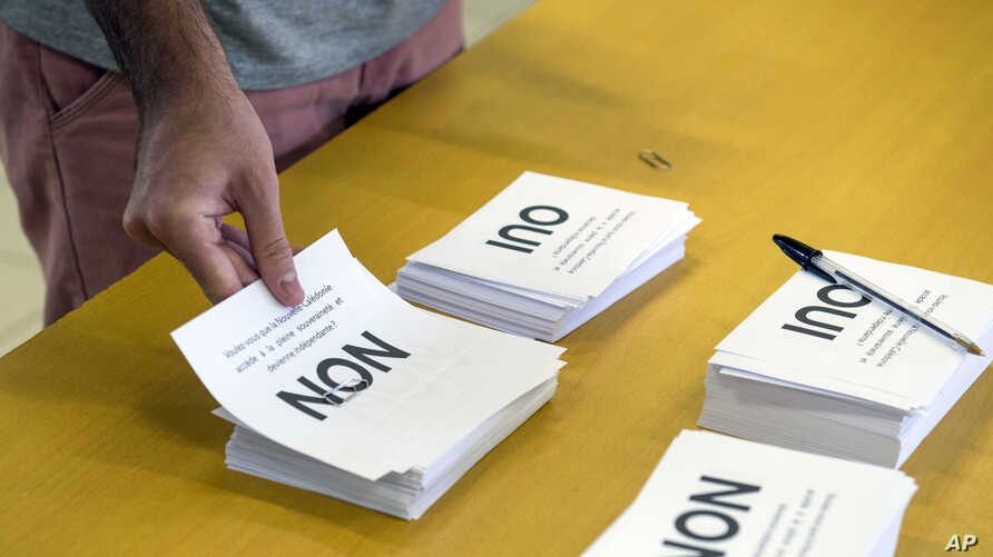 A man prepares to cast his vote at a polling station in Noumea, New Caledonia, as part of an independence referendum, Nov. 4, 2018.