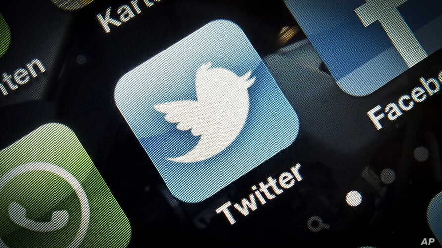 An icon for the Twitter application is seen on a mobile phone.