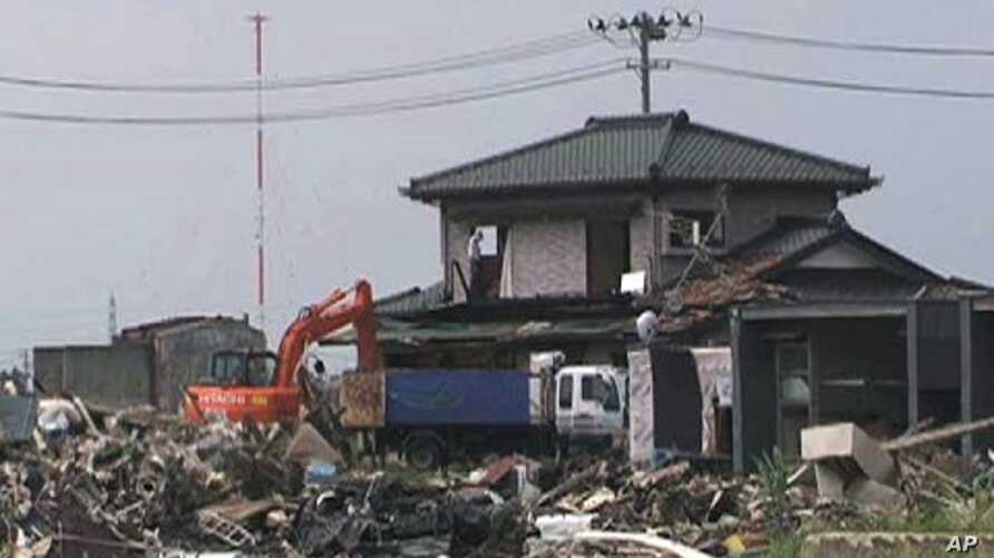 In Miyagi Prefecture alone, authorities estimate they will collect around 18 million metric tons of debris.  Workers continue clearing debris in July, 2011