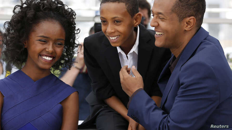 """Director Yared Zeleke (R), cast members Kidist Siyum (L) and Rediat Amare pose during a photocall for the film """"Lamb"""" in competition for the category """"Un Certain Regard"""" at the 68th Cannes Film Festival in Cannes, southern France, May 20, 2015."""