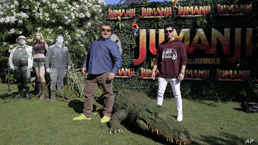 """Actors Jack Black, left, and Nick Jonas pose to the media during a photocall to promote the film """"Jumanji: Welcome to the jungle"""" in Barcelona, Spain, June 18, 2017."""