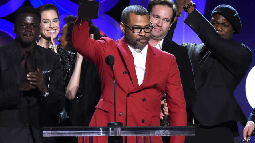 """Jordan Peele accepts the award for best feature for """"Get Out"""" at the 33rd Film Independent Spirit Awards, March 3, 2018, in Santa Monica, Calif."""