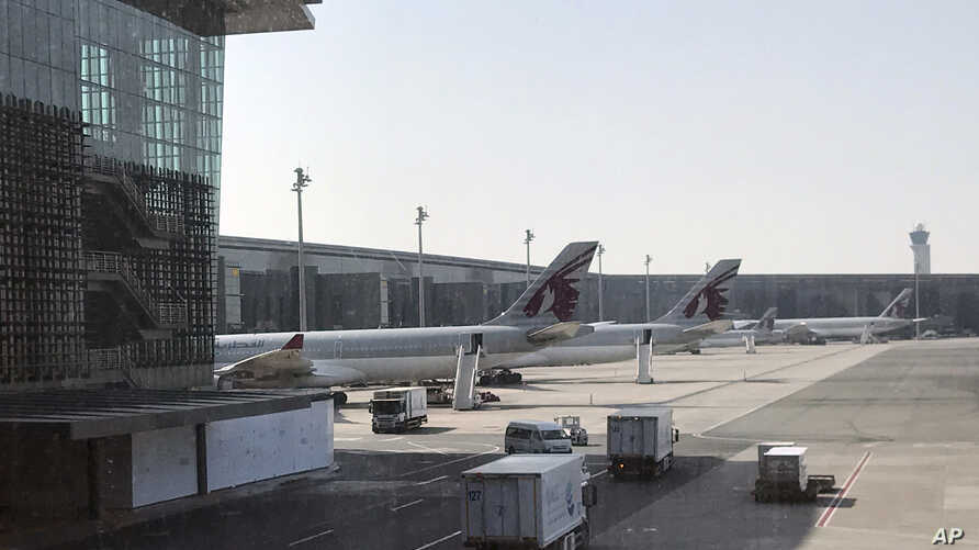 Qatar Airways planes are seen parked at the Hamad International Airport in Doha, Qatar, June 16, 2017.