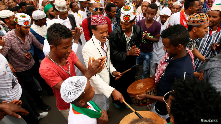 Muslim men sing after attending Eid al-Fitr prayers to mark the end of the holy fasting month of Ramadan in Addis Ababa, Ethiopia July 6, 2016.