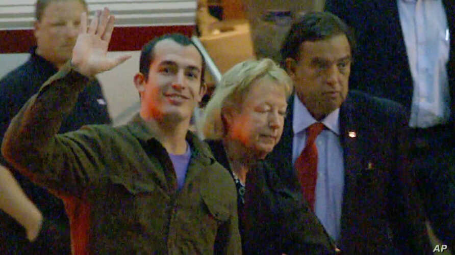 This image taken from a video shows Marine Sergeant Andrew Tahmooressi waving after arriving in Weston, Florida, Nov. 1, 2014.