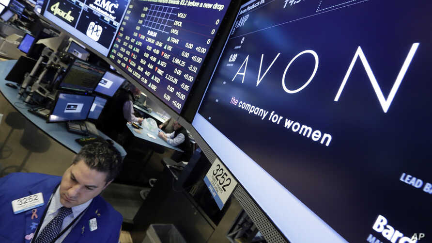 FILE - In this March 15, 2016 photo, specialist Ronnie Howard works under the Avon logo on the floor of the New York Stock Exchange.