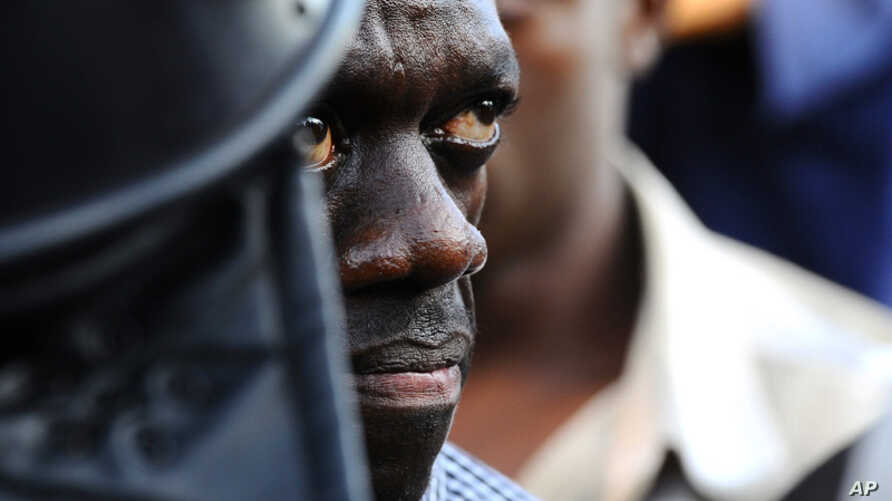 April 14: Uganda's Forum for Democratic Change leader Kizza Besigye is arrested by anti-riot policemen at the Kasangati suburb of the capital Kampala. (Reuters)