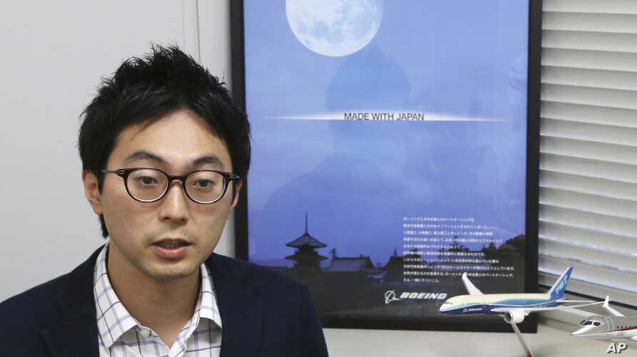"""In this Sept. 4, 2018, photo, Fumiaki Ebihara, the flying-car chief at the Ministry of Economy, Trade and Industry, speaks during a interview with the Associated Press in Tokyo, Tuesday, Sept. 4, 2018. The Japanese government has started a """"flying ca"""