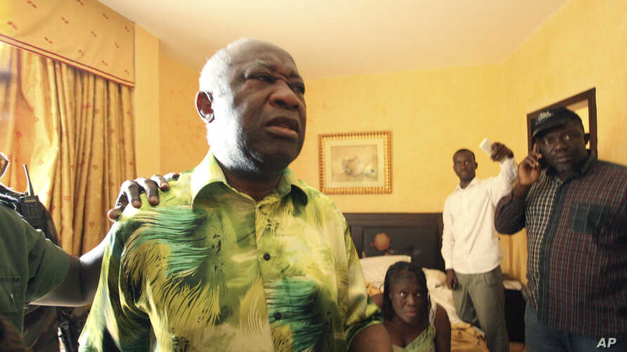 Ivorian strongman Laurent Gbagbo, left, and his wife Simone, are seen is the custody of republican forces loyal to election winner Alassane Ouattara at the Golf Hotel in Abidjan, Ivory Coast, April 11, 2011.
