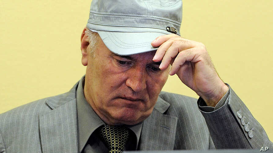 """June 3: Former Bosnian Serb Gen. Ratko Mladic removes his hat in the court room during his initial appearance at the U.N.'s Yugoslav war crimes tribunal in The Hague, Netherlands. Mladic told a United Nations war crimes court Friday he is """"a gravely"""