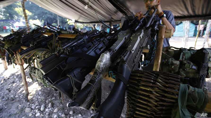 FILE - Weapons belonging to rebels of the Revolutionary Armed Forces of Colombia (FARC) are stored at a rebel camp in La Carmelita near Puerto Asis in Colombia's southwestern state of Putumayo, Feb. 28, 2017.