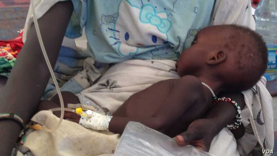 A child is treated for cholera in South Sudan. Malnourishment resulting from the ongoing crisis in the country has left children even more vulnerable to the disease, which has killed 27 people as of June 2, 2014.